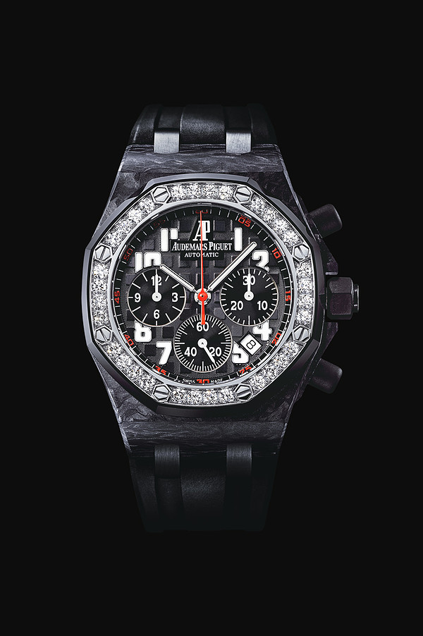Selfwinding chronograph with date display and small seconds at 6 o'clock. Forged carbon case, black dial, black strap. 32 brilliant-cut diamonds, ~1.25 carats.