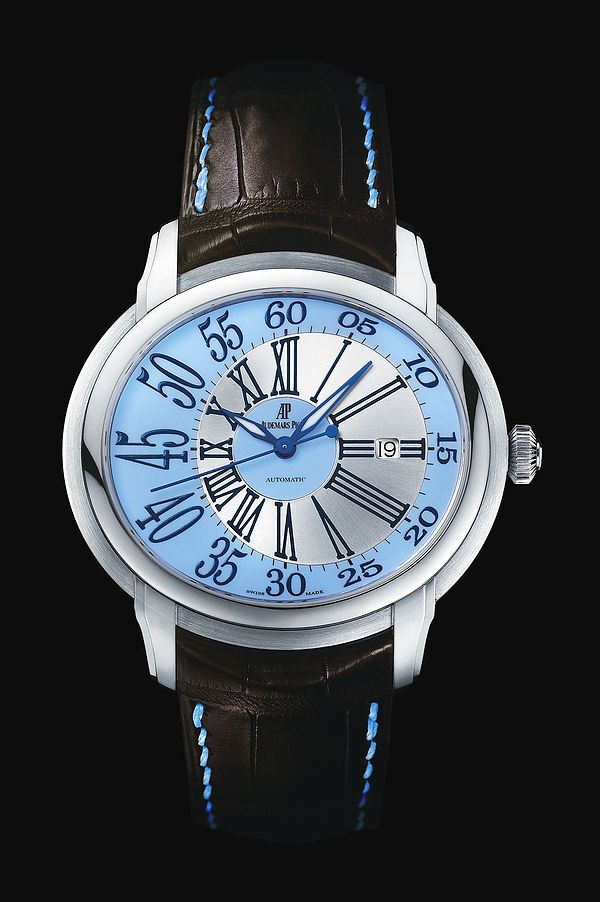 Selfwinding watch with date display and centre seconds. 18-carat white gold case, blue dial, brown strap. Availability to be confirmed.